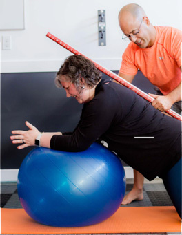 Adam-working-with-client-exercise-ball